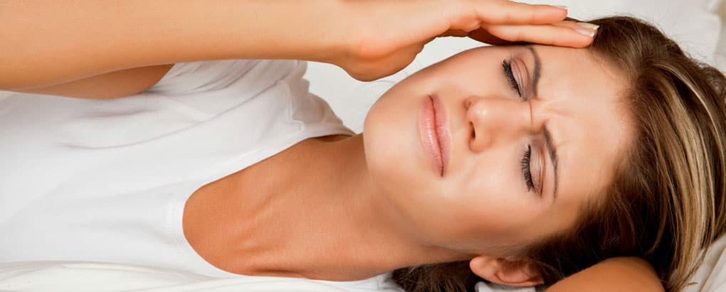 Woman suffering from TMD or TMJ disorders